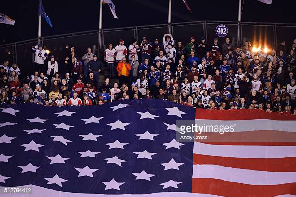 Hockey fans displayed the American flag for the National Anthem before the NHL Stadium Series game featuring the Colorado Avalanche and the Detroit...