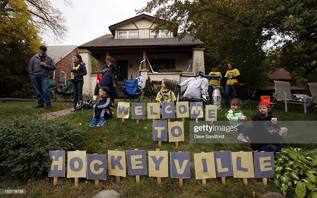 Hockey fans gather for a parade featuring the Stanley Cup as it moves down Main Street on route to the Fun Fair at the Stirling and District Recreation Centre during Kraft Hockeyville Day 1 on September 30, 2012 in Stirling, Ontario, Canada.