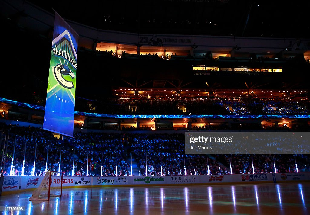 Hockey fans look on before the start of the NHL game between the Vancouver Canucks and the Tampa Bay Lightning at Rogers Arena October 18, 2014 in Vancouver, British Columbia, Canada.