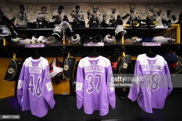 Hockey Fights Cancer jerseys in the stalls of David Krejci Patrice Bergeron and David Pastrnak of the Boston Bruins before the game against the...