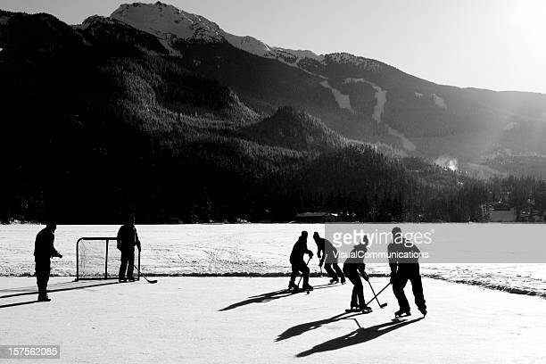 hockey game on frozen lake.