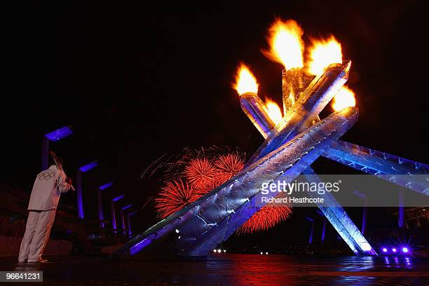 Hockey great Wayne Gretzky lights the Olympic Cauldron during the Opening Ceremony of the 2010 Vancouver Winter Olympics at BC Place on February 12...