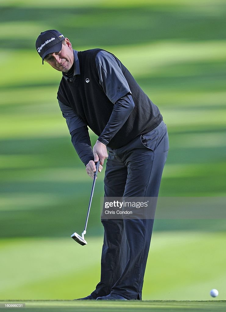 Hockey Great Wayne Gretzky putts for birdie on the 18th hole during the second round of the AT&T Pebble Beach National Pro-Am at Spyglass Hill Golf Course on February 8, 2013 in Pebble Beach, California.