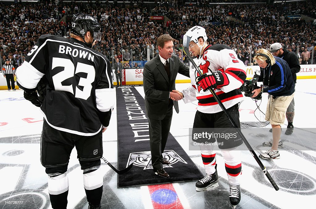 Hockey great Wayne Gretzky (C) shakes hands with Zach Parise #9 of the New Jersey Devils (R) and Dustin Brown #23 of the Los Angeles Kings (L) after he dropped the ceremonial first puck before Game Three of the 2012 Stanley Cup Final at the Staples Center on June 4, 2012 in Los Angeles, California.