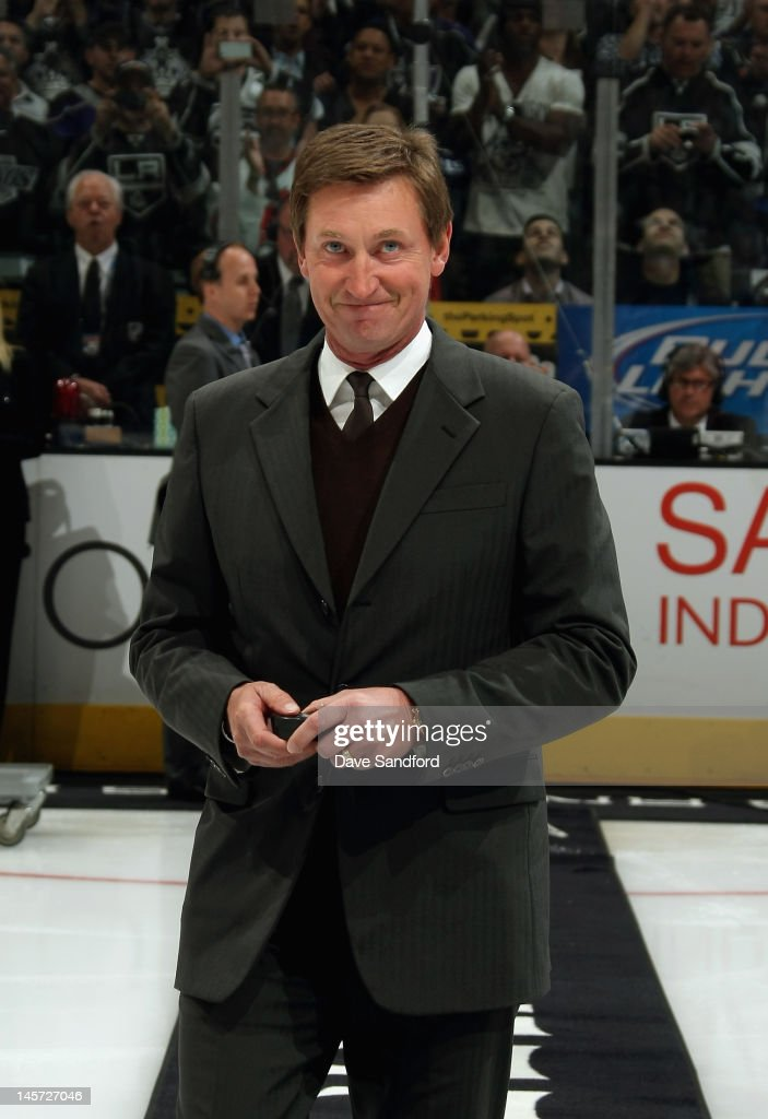 Hockey great Wayne Gretzky takes the ice for the ceremonial puck drop before the New Jersey Devils play the Los Angeles Kings in Game Three of the 2012 Stanley Cup Final at the Staples Center on June 4, 2012 in Los Angeles, California.