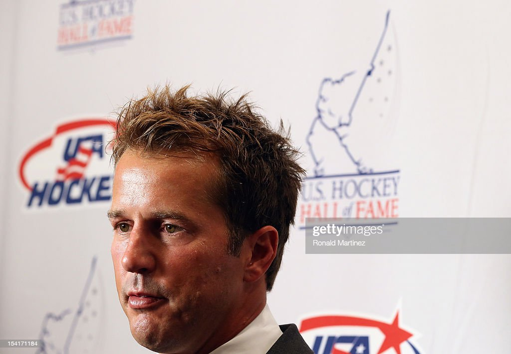 U.S. Hockey Hall of Fame Class of 2012 recipient, <a gi-track='captionPersonalityLinkClicked' href=/galleries/search?phrase=Mike+Modano&family=editorial&specificpeople=202511 ng-click='$event.stopPropagation()'>Mike Modano</a> talks with the media before the 40th annual U.S. Hockey Hall of Fame Induction Ceremony & Dinner at Plaza of the Americas on October 15, 2012 in Dallas, Texas.