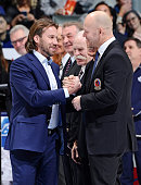 Hockey Hall of Fame inductee Peter Forsberg shakes hands with former Toronto Maple Leafs Captain Mats Sundin during an on ice ceremony prior to NHL...