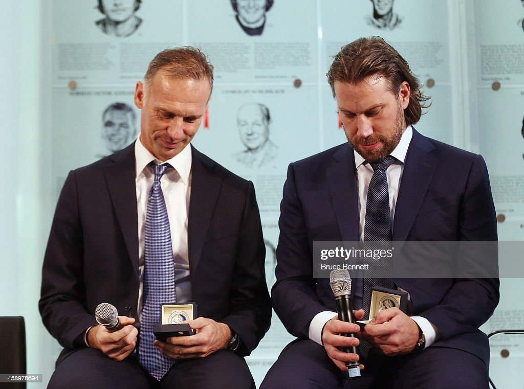 2014 Hockey Hall of Fame inductees Dominik Hasek and Peter Forsberg look at the Hall rings during a photo opportunity at the Hockey Hall of Fame on...