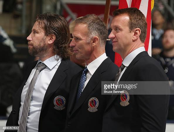 Hockey Hall of Fame inductees Peter Forsberg Dominik Hasek and Rob Blake take part in the Hall blazer presentation prior to the Legends Classic Game...