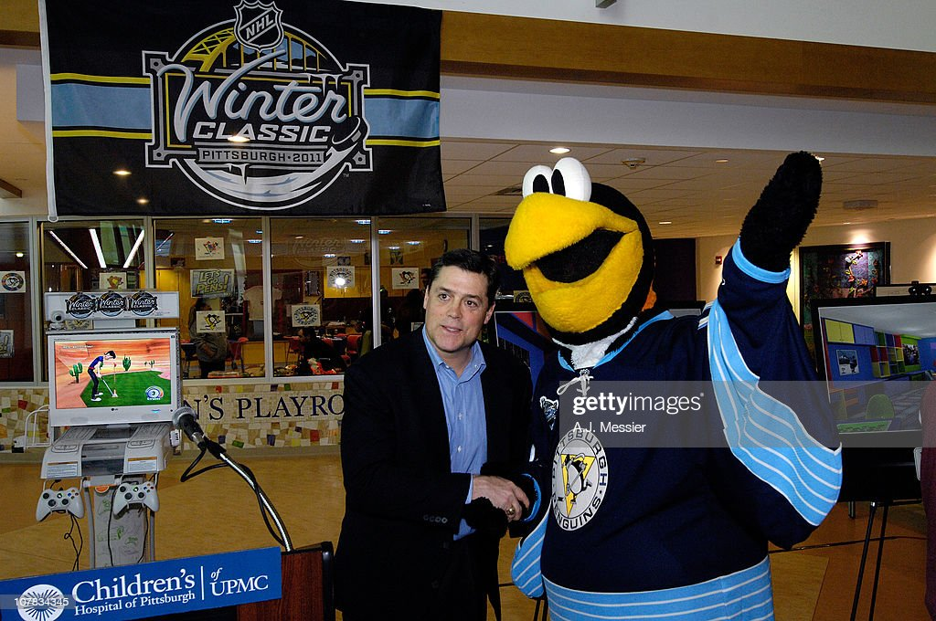 Hockey Hall of Fame NHL player <a gi-track='captionPersonalityLinkClicked' href=/galleries/search?phrase=Pat+LaFontaine&family=editorial&specificpeople=213982 ng-click='$event.stopPropagation()'>Pat LaFontaine</a> (L) and Pittsburgh Penguins mascot Iceburgh(R) attend the 2011 NHL Winter Classic Childrens Hospital Visit at the University of Pittsburgh Medical Center on December 31, 2010 in Pittsburgh, Pennsylvania.