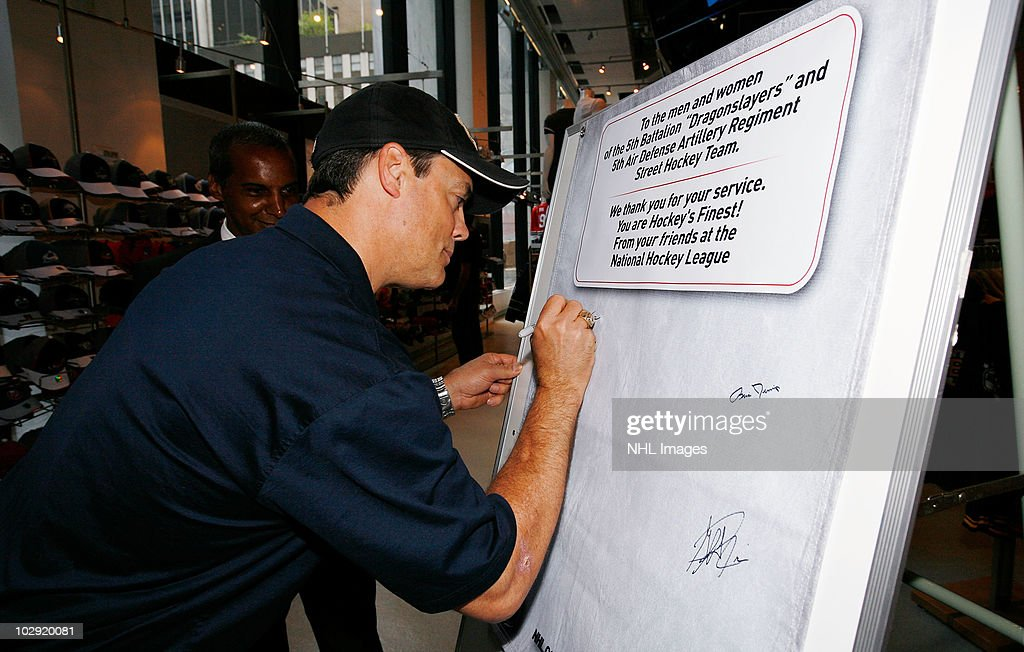 Hockey Hall of Fame NHL player Pat LaFontaine signs message board for the troops at NHL, UPS & U.S. Army Street Hockey Equipment Donation To Troops In Iraq event at the NHL Powered by Reebok Store on June 7, 2010 in New York.