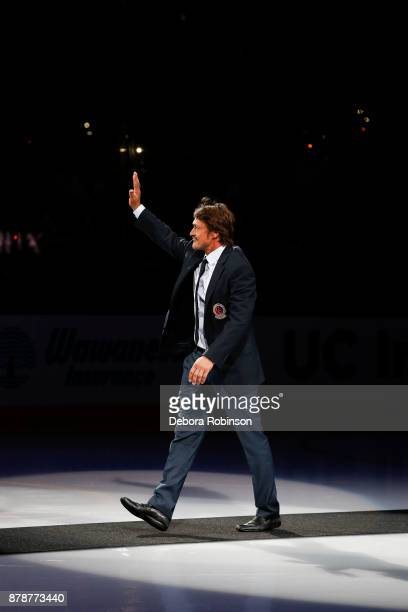 Hockey Hall of Famer and former Anaheim Duck Teemu Selanne waves during 'Hall of Fame Night' celebrating his and Paul Kariya's induction to the Hall...