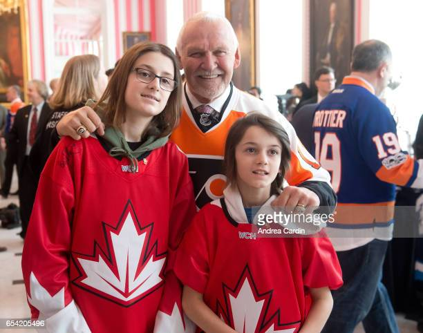 Hockey Hall of Famer Bernie Parent poses with youth hockey players from the Ottawa and Gatineau region during the Stanley Cup Homecoming as part of...