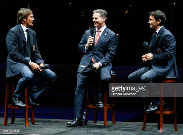 Hockey Hall of Famers and former Anaheim Ducks Teemu Selanne left and Paul Kariya right talk with Ducks Broadcaster Brian Hayward during 'Hall of...