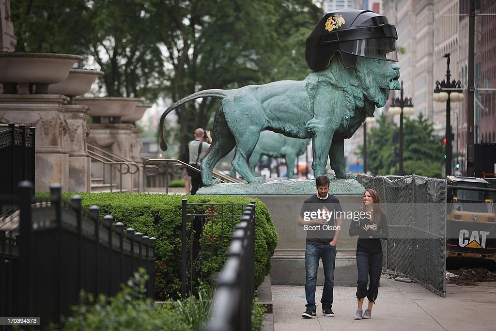 A hockey helmet celebrating the Chicago Blackhawks is placed on the head of an Edward Kemeys lion which stands at the front of the Art Institute of Chicago on June 12, 2013 in Chicago, Illinois. The Blackhawks will match up against the Boston Bruins tonight at the United Center in the first game on the NHL Stanley Cup playoffs.