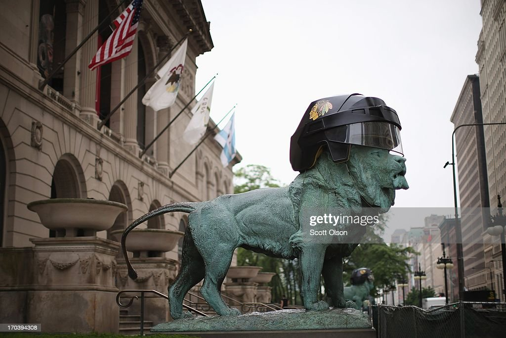 Hockey helmets are placed on the heads of Edward Kemeys' lions in celebration of the Chicago Blackhawks at the front of the Art Institute of Chicago on June 12, 2013 in Chicago, Illinois. The Blackhawks will match up against the Boston Bruins tonight at the United Center in the first game on the NHL Stanley Cup playoffs.