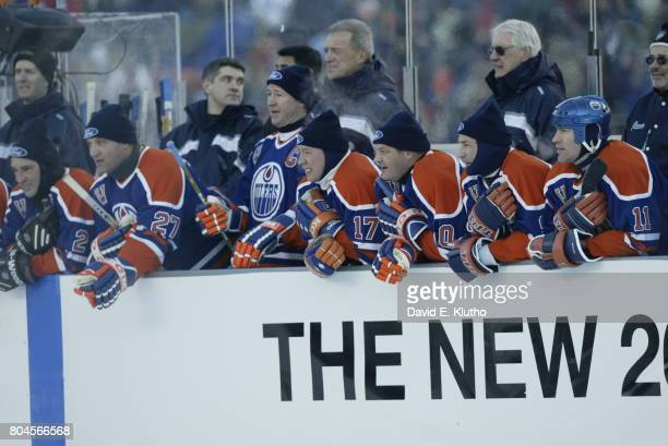 Heritage Classic Edmonton Oilers Dave Semenko Kevin Lowe Jari Kurri Esa Tikkanen Glenn Anderson and Mark Messier at bench during game vs Montreal...