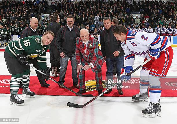 Hockey Legend Don Cherry drops the ceremonial puck between Liam Maaskant of the Kitchener Rangers and Max Domi of the London Knights prior to play in...