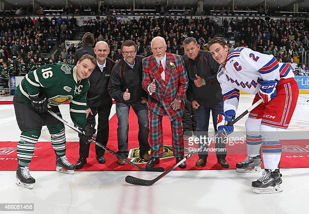 Hockey Legend Don Cherry gets set to drop the ceremonial puck between Liam Maaskant of the Kitchener Rangers and Max Domi of the London Knights prior...