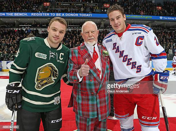 Hockey Legend Don Cherry poses for a photo with Liam Maaskant of the Kitchener Rangers and Max Domi of the London Knights prior to play in an OHL...