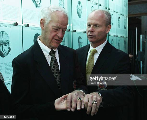 Hockey legend Gordie Howe and 2011 Hall of Fame inductee Mark Howe converse during a photo opportunity at the Hockey Hall Of Fame on November 14 2011...