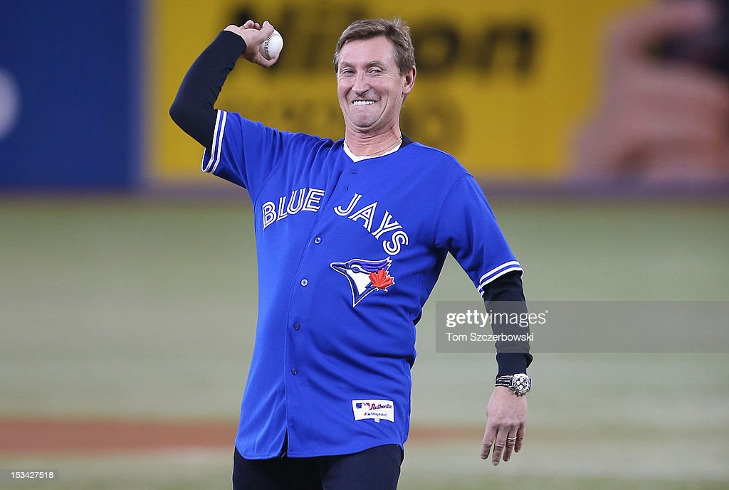 Hockey legend Wayne Gretzky throws out the first pitch before the Minnesota Twins MLB game against the Toronto Blue Jays on October 1, 2012 at Rogers Centre in Toronto, Ontario, Canada.