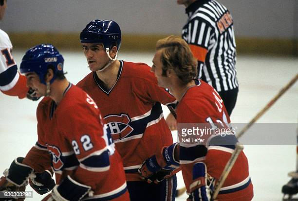Montreal Canadiens Jacques Lemaire with teammates during game vs New York Islanders at Nassau Coliseum Uniondale NY CREDIT Neil Leifer