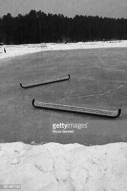 Hockey nets rest on the rink before dawn and the 2013 USA Hockey Pond Hockey National Championships on February 10 2013 in Eagle River Wisconsin The...