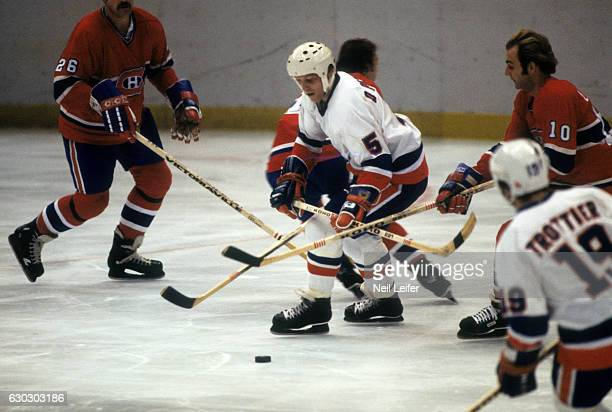 New York Islanders Denis Potvin in action vs Montreal Canadiens Guy Lafleur at Nassau Coliseum Uniondale NY CREDIT Neil Leifer