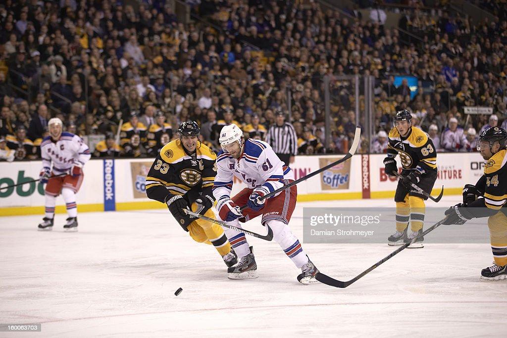 New York Rangers Rick Nash (61) in action vs Boston Bruins Zdeno Chara (33) at TD Garden. Damian Strohmeyer F87 )