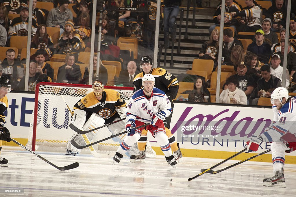 New York Rangers Ryan Callahan (24) in action vs Boston Bruins goalie Tuukka Rask (40) and Johnny Boychuk (55) at TD Garden. Damian Strohmeyer F1 )