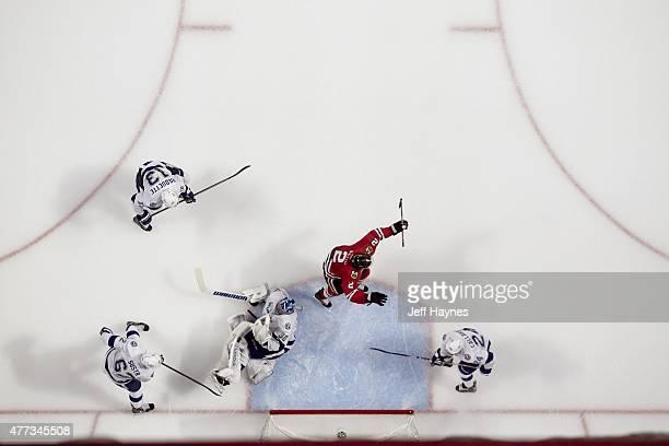 NHL Finals Aerial view of Chicago Blackhawks Duncan Keith victorious after scoring goal vs Tampa Bay Lightning goalie Ben Bishop at United Center...