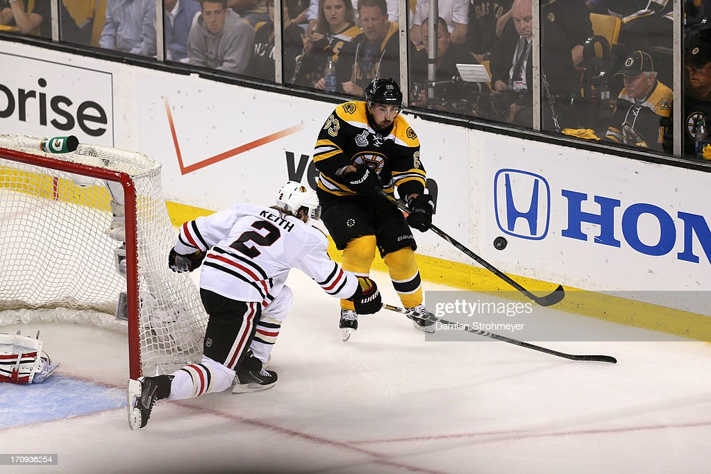 Boston Bruins Brad Marchand (63) in action vs Chicago Blackhawks Duncan Keith (2) at TD Garden. Game 4. Damian Strohmeyer F15 )