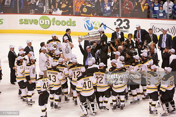 NHL Finals Boston Bruins head coach Claude Julien and team victorious with Stanley Cup trophy after win vs Vancouver Canucks at Rogers Arena Game 7...