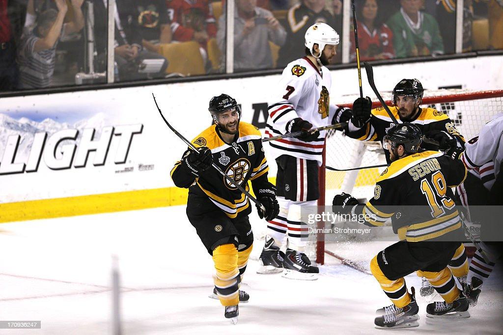Boston Bruins Patrice Bergeron (37) victorious after Tyler Seguin (19) goal vs Chicago Blackhawks at TD Garden. Game 4. Damian Strohmeyer F25 )