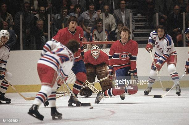 NHL Finals Montreal Canadiens Serge Savard goalie Ken Dryden and Larry Robinson in action defend shot by New York Rangers Don Murdoch Game 3 New York...