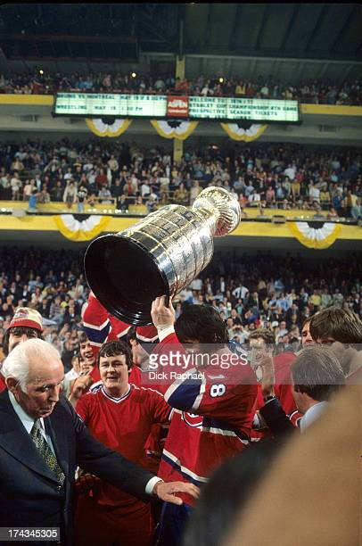 NHL Finals Montreal Canadiens Serge Savard victorious holding up Stanley Cup after winning game and series vs Boston Bruins at Boston Garden Game 4...