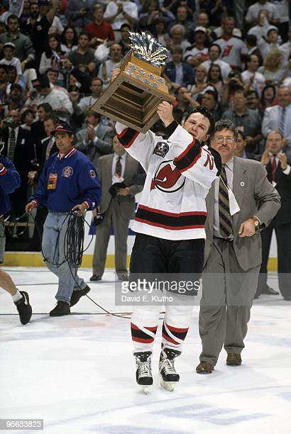 NHL Finals New Jersey Devils Claude Lemieux victorious with Conn Smythe trophy after winning Game 4 and series vs Detroit Red Wings East Rutherford...