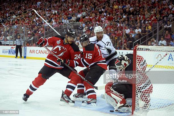 NHL Finals New Jersey Devils goalie Martin Brodeur Bryce Salvador and Petr Sykora in action vs Los Angeles Kings Jeff Carter at Prudential Center...