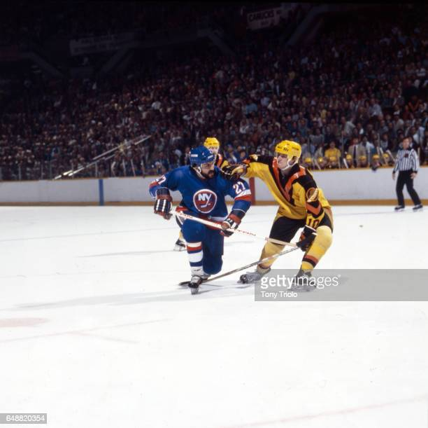 NHL Finals New York Islanders John Tonelli in action vs Vancouver Canucks Bobby Schmautz at Pacific Coliseum Game 4 Vancouver Canada 5/16/1982 CREDIT...