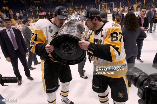 NHL Finals Pittsburgh Penguins Evgeni Malkin and Sidney Crosby victorious kissing Stanley Cup after winning game and series vs Nashville Predators at...