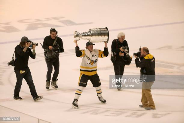 NHL Finals Pittsburgh Penguins Jake Guentzel victorious hoisting Stanley Cup over his head after winning game and series vs Nashville Predators at...