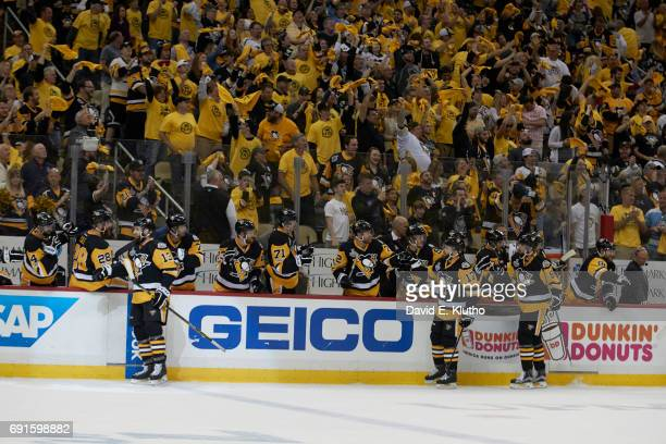 NHL Finals Pittsburgh Penguins Nick Bonino Bryan Rust and Brian Dumoulin victorious with teammates on bench during game vs Nashville Predators at PPG...