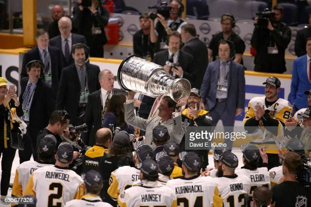 NHL Finals Pittsburgh Penguins owner Mario Lemieux victorious hoisting Stanley Cup over his head after winning game and series vs Nashville Predators...