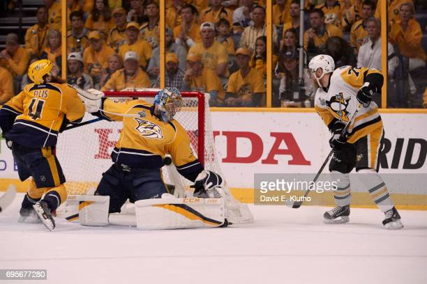 NHL Finals Pittsburgh Penguins Patric Hornqvist in action scoring game winning goal vs Nashville Predators goalie Pekka Rinne at Bridgestone Arena...