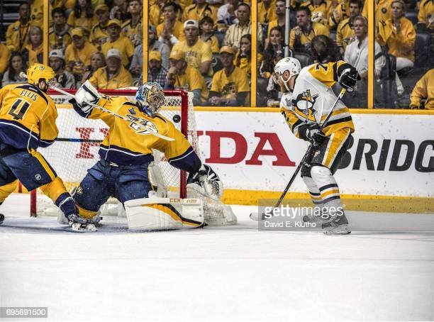 NHL Finals Pittsburgh Penguins Patric Hornqvist in action scoring gamewinning goal vs Nashville Predators Pekka Rinne at Bridgestone Arena Game 6...