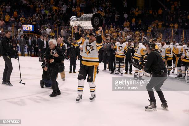 NHL Finals Pittsburgh Penguins Patric Hornqvist victorious hoisting Stanley Cup over his head after winning game and series vs Nashville Predators at...