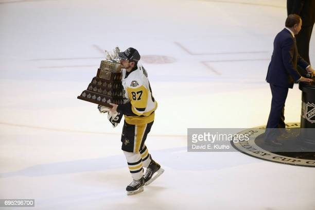 NHL Finals Pittsburgh Penguins Sidney Crosby victorious on ice with Conn Smythe award after winning game and series vs Nashville Predators at...