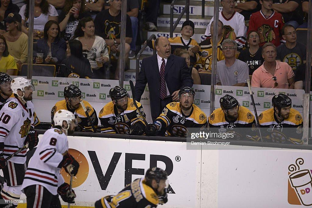 View of Boston Bruins coach Claude Julien on sidelines during game vs Chicago Blackhawks Patrick Sharp (10) at TD Garden. Game 6. Damian Strohmeyer F21 )