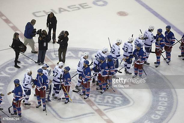 NHL Playoffs Aerial rear view New York Rangers players shaking hands with Tampa Bay Lightning players on ice after game at Madison Square Garden Game...